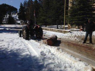 George Shawool Towing the Log with the Tractor