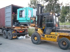 CNC Machine Being Unloaded
