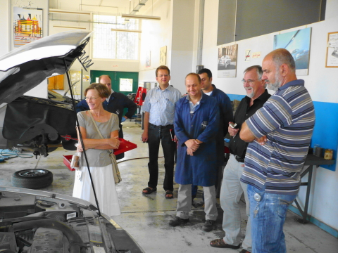 Ambassador looking at pick-up truck donated by GIZ